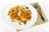 stock photo of thighs  - Roasted chicken thighs with Rosemary - JPG