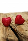foto of heartfelt  - Red heart on a background of wood - JPG