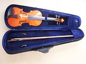 stock photo of violin  - Violin case with violin and bow in isolated background - JPG