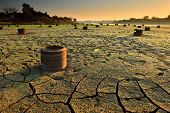 stock photo of water shortage  - dry cracks in the land - JPG