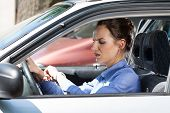 pic of independent woman  - Woman late for work in a car - JPG