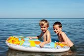 picture of 7-year-old  - two brothers playing in the water  - JPG