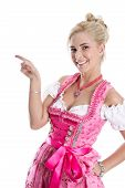 picture of dress-making  - Beautiful bavarian woman isolated making promotion for Oktoberfest in munich wearing bavarian dress - JPG