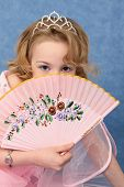 foto of ruddy-faced  - Girl coyly covered her face with pink glamorous fan - JPG
