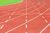 stock photo of olympiad  - The Running track and green filed  - JPG