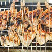stock photo of brazier  - grilled chicken wings on brazier close up - JPG