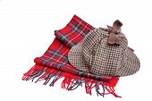 stock photo of sherlock  - Deerhunter or Sherlock Holmes cap and tartan scarves Isolated on white - JPG