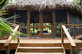 picture of tiki  - A large gazebo or tiki hut in tropical setting - JPG