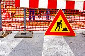 stock photo of reconstruction  - Road signs in a street under reconstruction symbol - JPG