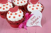 image of red velvet cake  - Happy Valentine red velvet cupcakes with love messages on pink vintage wood background with greeting card - JPG
