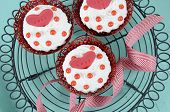 image of red velvet cake  - Happy Valentine red velvet cupcakes with love messages on vintage baking rack on green teal blue sixties style vintage wood background  - JPG