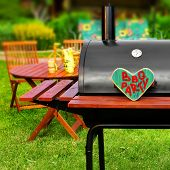 picture of bbq party  - BBQ Party Sign on Wooden Heart at Barbecue Appliance on the Backyard at Summertime - JPG