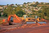picture of road construction  - digger working on a road construction site - JPG