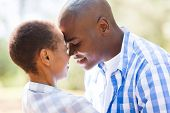 picture of flirt  - intimate african american couple flirting outdoors - JPG