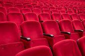 foto of cinema auditorium  - empty red cinema or theater seats - JPG