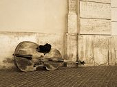 pic of cello  - A cello or contrabass left out on the street before playing - JPG