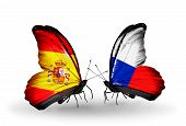 stock photo of spanish money  - Two butterflies with flags on wings as symbol of relations Spain and Czech - JPG