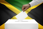 foto of jamaican flag  - Ballot box with national flag on background  - JPG