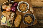 picture of french pastry  - It is the French onion soup with baked toast with cheese on top rustic pastry - JPG