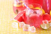 image of pitcher  - Pink lemonade in glasses and pitcher on bright background - JPG