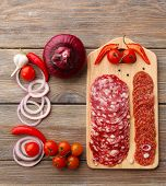picture of chili peppers  - Sliced salami with chili pepper - JPG