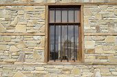 image of tile cladding  - Stone cladding plates on the wall with window closeup - JPG
