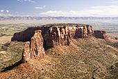 image of semi-arid  - Independence Monument located in the Colorado National Monument raises above the Colorado River Valley - JPG