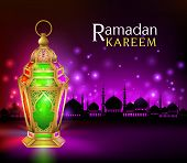 stock photo of kareem  - Beautiful Elegant Ramadan Kareem Lantern or Fanous in Gold With Colorful Lights in Silhouette Mosque Background for the Holy Month Occasion of fasting - JPG