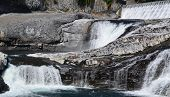 stock photo of hydroelectric  - Pools of water and falls on the rocks at the hydroelectric plant - JPG