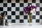 Постер, плакат: lilacs in a vase and kitchen utensils