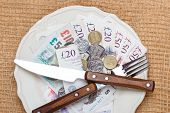 stock photo of british pound sterling note  - Cost of living price of food and eating wealth concept - JPG