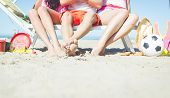 pic of frisbee  - three friends sitting on a beach deck with composition of beach games - JPG