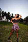 picture of jamaican  - Stock image of a Jamaican woman posing in fashionable clothing in the park - JPG