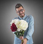 foto of nerds  - Nerd boy woos with a flowers bouquet - JPG