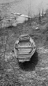stock photo of old boat  - Old boat wooden brown in  the reservoir - JPG