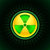 stock photo of radium  - Glowing sign of radiation with a pattern on a circle on a dark background - JPG