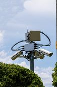 pic of cctv  - Security cctv camera in front of blue sky  - JPG