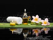 stock photo of frangipani  - Still life with and candle, frangipani ,soap ,palm with row of plant stem   - JPG