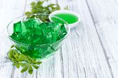 picture of jello  - Portion of homemade Woodruff Jello (on a bright background) ** Note: Shallow depth of field - JPG