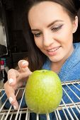 pic of refrigerator  - happy girl taking green apple from refrigerator - JPG