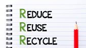 picture of reuse recycle  - Reduce Reuse Recycle Text written on notebook page red pencil on the right - JPG