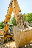 image of excavator  - The excavator working on a construction site - JPG