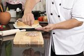 stock photo of hamburger-steak  - Chef putting salt on to raw beef Burger  - JPG