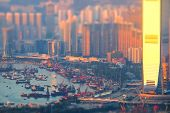 stock photo of tilt  - Tilt shift aerial view panorama of Hong Kong skyline and Victoria Harbor at sunset - JPG
