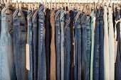 pic of denim jeans  - View of many denim jeans in the clothing store - JPG