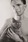 foto of silver-hair  - beautiful dark haired young man with silver makeup on his face and cat in hands - JPG