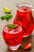 pic of refreshing  - Refreshing summer drink with Strawberry in jug and glasses on the vintage wooden table