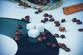 foto of sugar cube  - Sugar cubes on a vinyl plate among coffee beans - JPG