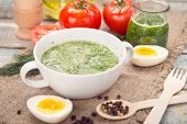 foto of pesto sauce  - sauce of pesto near a tomato olive oil and eggs in a studi - JPG