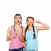 stock photo of crazy face  - Paint on the face of pretty girl friends having fun - JPG
